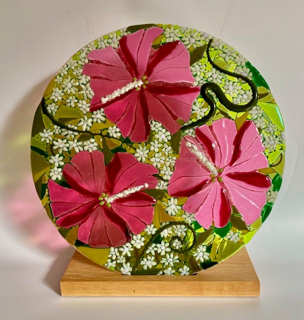 'Pink Hibiscus' fused glass roundel, 30cm diameter on oak stand